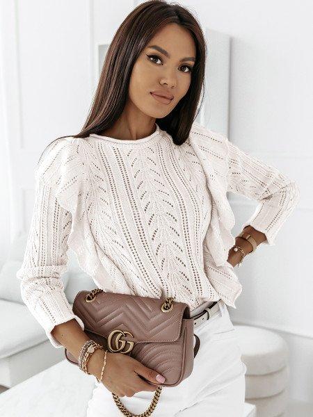 Ażurowy sweter z falbanami...